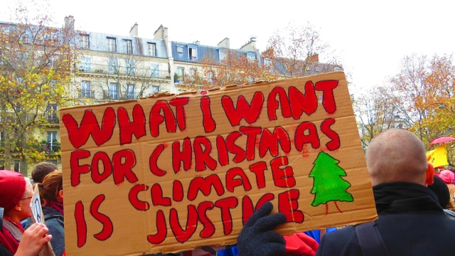 "activist's sign: ""What I want for Christmas is climate justice"""