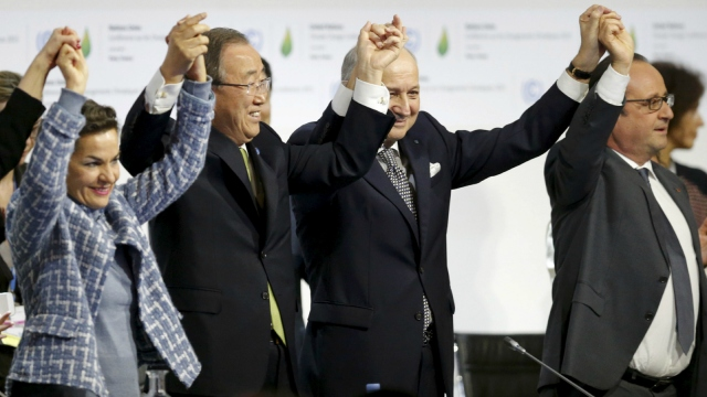 From L-R, Christiana Figueres, Executive Secretary of the UN Framework Convention on Climate Change, United Nations Secretary-General Ban Ki-moon, French Foreign Affairs Minister Laurent Fabius, President-designate of COP21 and French President Francois Hollande react during the final plenary session at the World Climate Change Conference 2015 (COP21) at Le Bourget, near Paris, France, December 12, 2015.