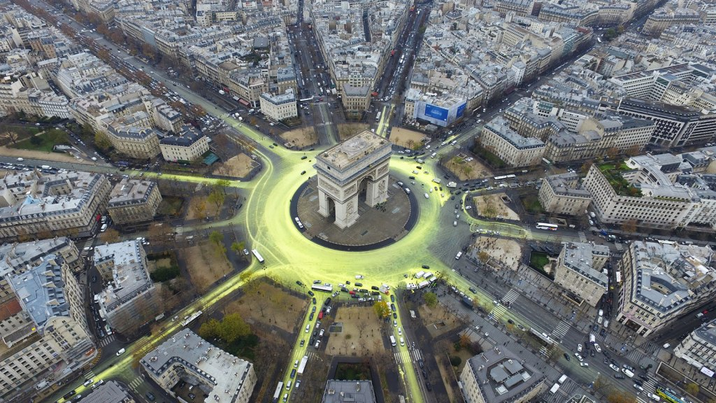 Greenpeace activists create a solar symbol around the world-famous Paris landmark, the Arc de Triomphe.