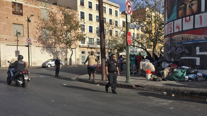 Private security officer Patton patrols Crocker and 5th in the Skid Row area of Los Angeles, Calif.