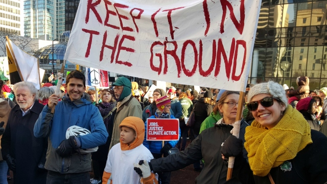 """keep it in the ground"" protest banner"