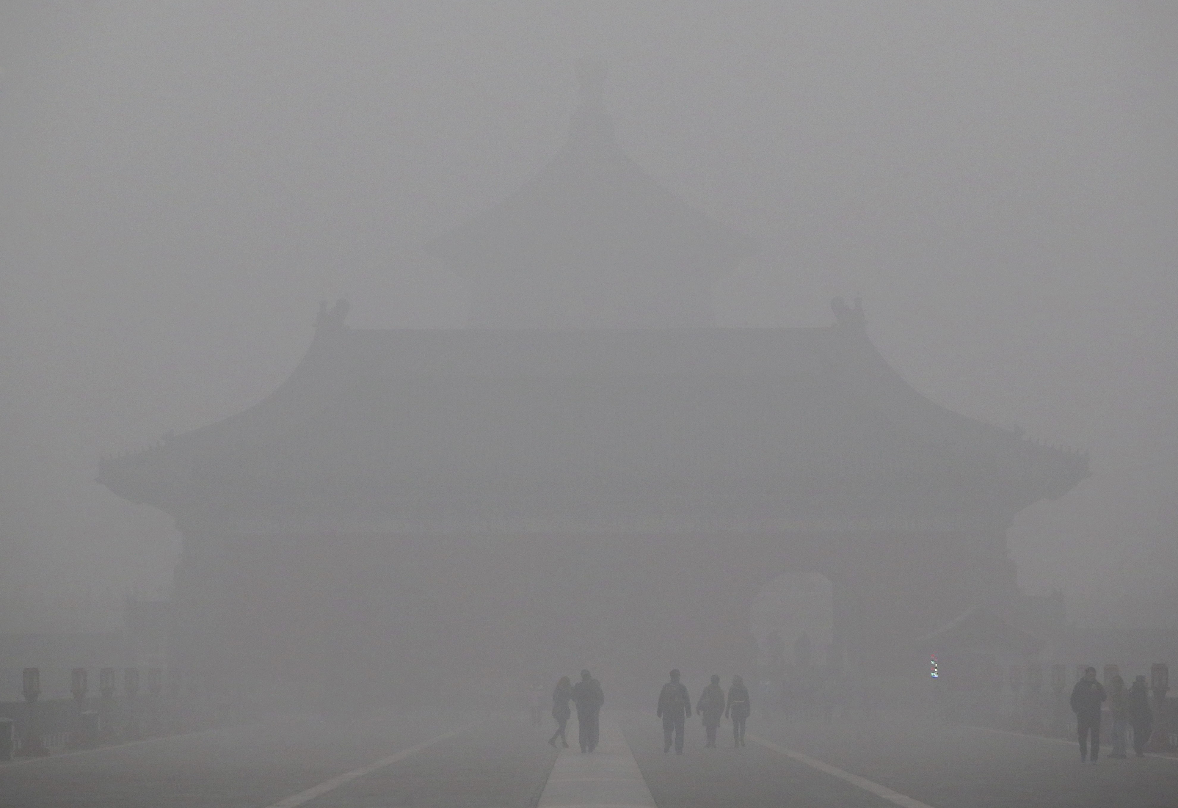 Beijing's Temple of Heaven is barely visible in thick smog.