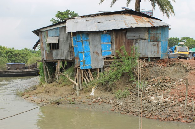 The role of climate migration in the COP21 agreement is precarious, much like this structure perched on the receding shoreline of Bhola.
