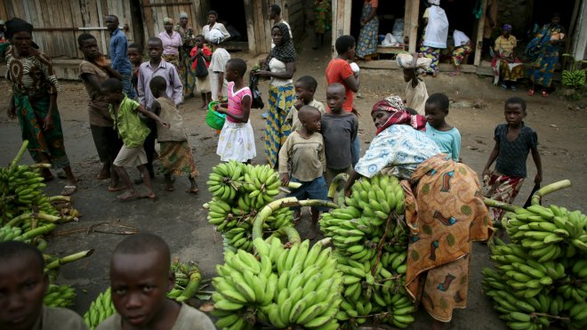 People sell bananas in an open market in a village near Bujumbura, Burundi