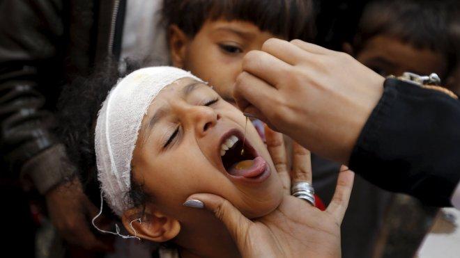 A boy gets vitamin A drops at a school in Yemen