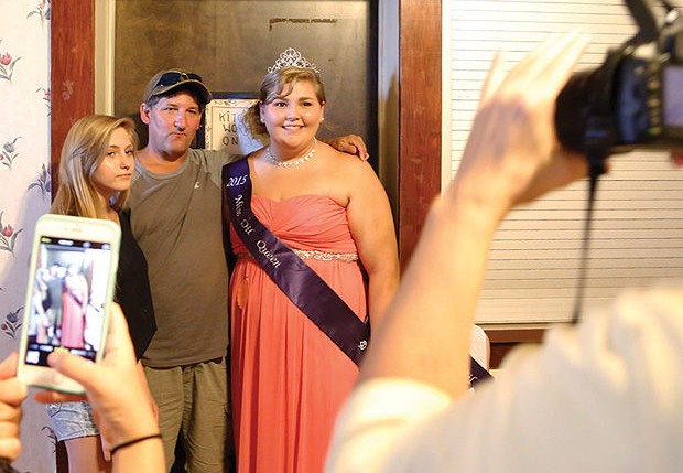 A recent winner of the Titusville, Penn., pageant poses with family members.