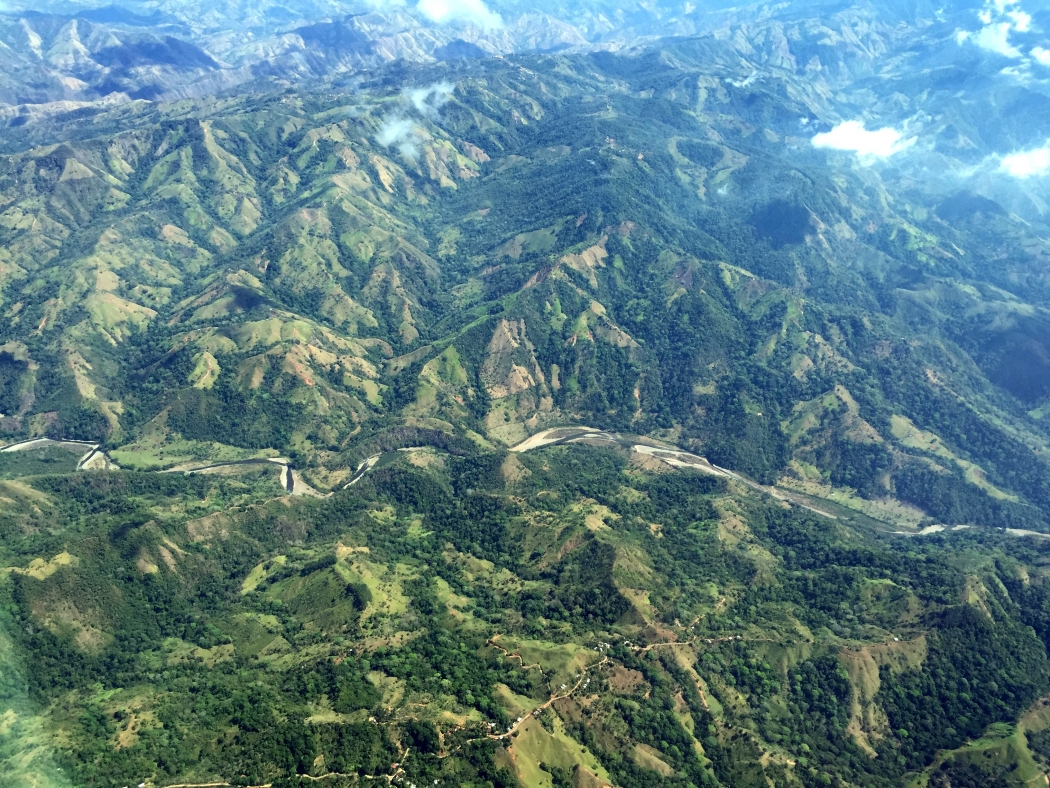 An aerial photograph of primary and secondary forest and agriculture fields on the Southern Pacific Coast of Costa Rica.