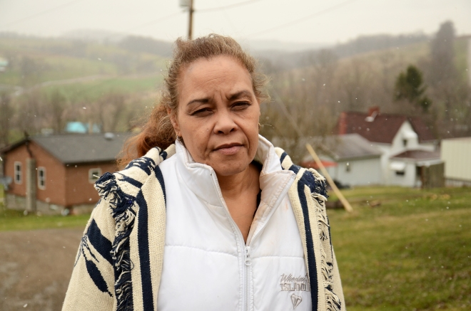 Jeannie Moten lives down the street from the Eakins. She has no running water at her home and receives drinking-water donations, as do several of her neighbors.