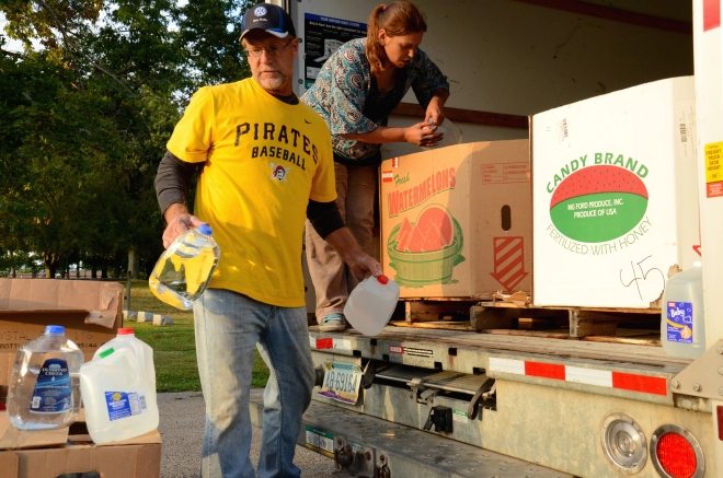 North of Pittsburgh, volunteers prepare for a weekly water drive serving residents of Connoquenessing Township.