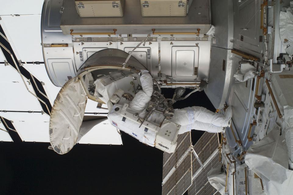 NASA astronaut Ron Garan egresses the International Space Station's Quest airlock at the beginning of the last spacewalk conducted while a space shuttle is docked to the station in this photo provided by NASA and taken July 12, 2011.