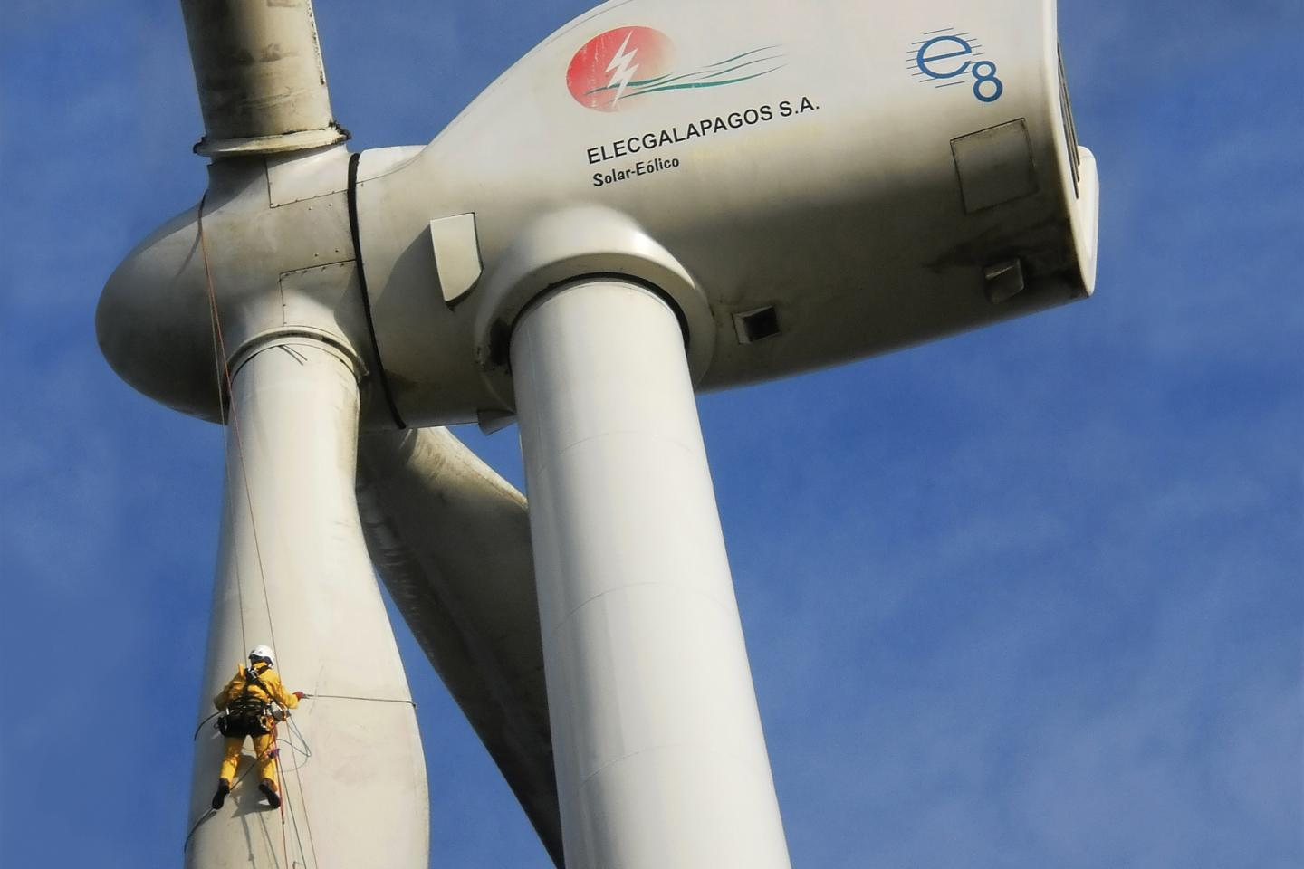 Workers clean the blades on a wind turbine on San Cristóbal Island in the Galapagos. The turbine provides 30 percent of the electricity consumed on San Cristóbal, replacing 2.3 million gallons of diesel fuel and avoiding 21,000 tons of carbon dioxide emissions.