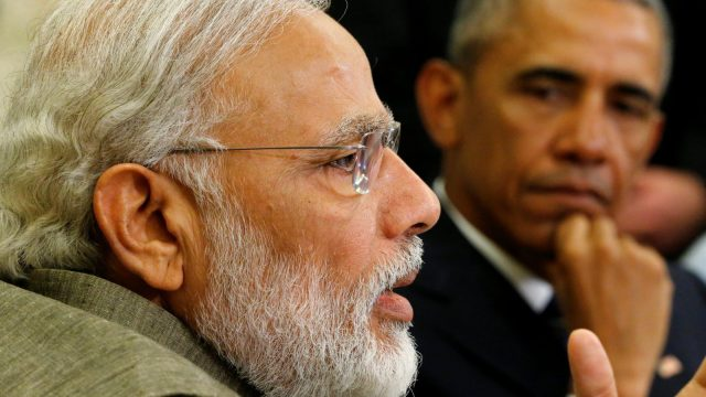 India's Prime Minister Narendra Modi (L) delivers remarks to reporters after meeting with U.S. President Barack Obama (R) in the Oval Office at the White House in Washington, U.S. June 7, 2016.
