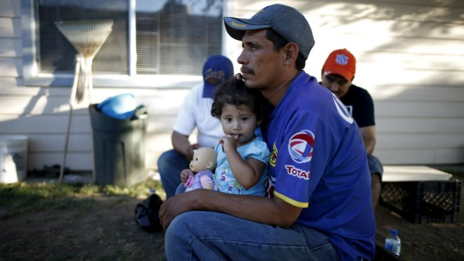 Farm worker Jose Adolfo Casares and his daughter at a migrant farm labour housing center in Bakersfield, California