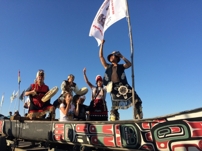 Tlingit artist Doug Chilton and his canoe traveled 2,800 miles from Alaska to North Dakota to take part in this week's three-day canoe journey down the Missouri River to protest the Dakota Access Pipeline. On Tuesday, Chilton and a caravan of Northwest Indian tribes arrived at Red Warrior Camp near Cannon Ball, N.D. to a warm welcome from onlookers.