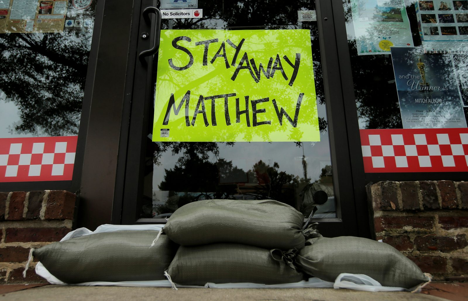 Sandbags are seen in front of a business ahead of Hurricane Matthew in Georgetown