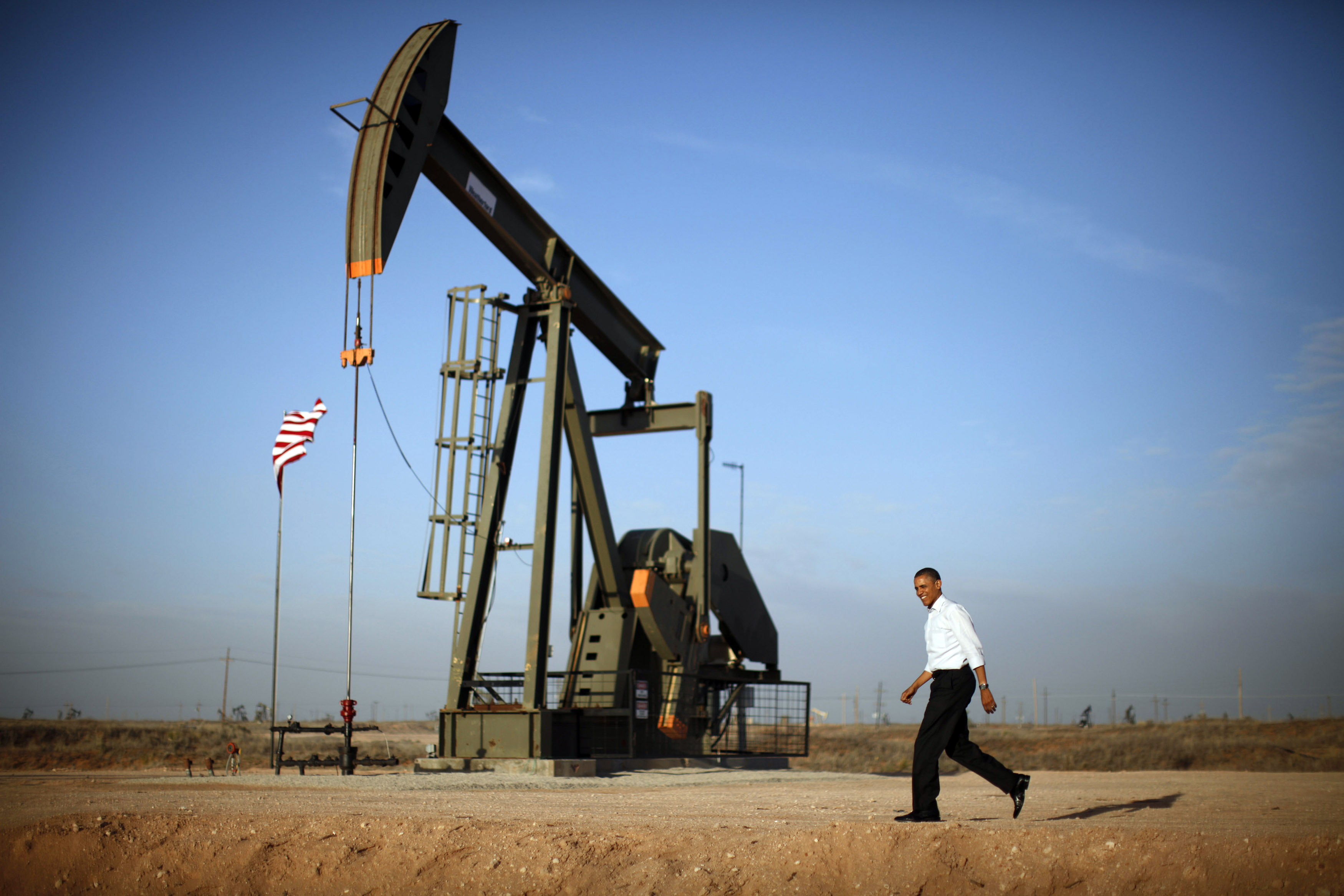 U.S. President Barack Obama walks past a pumpjack on his way to deliver remarks on energy independence at Maljamar Cooperative Association Unit in New Mexico.