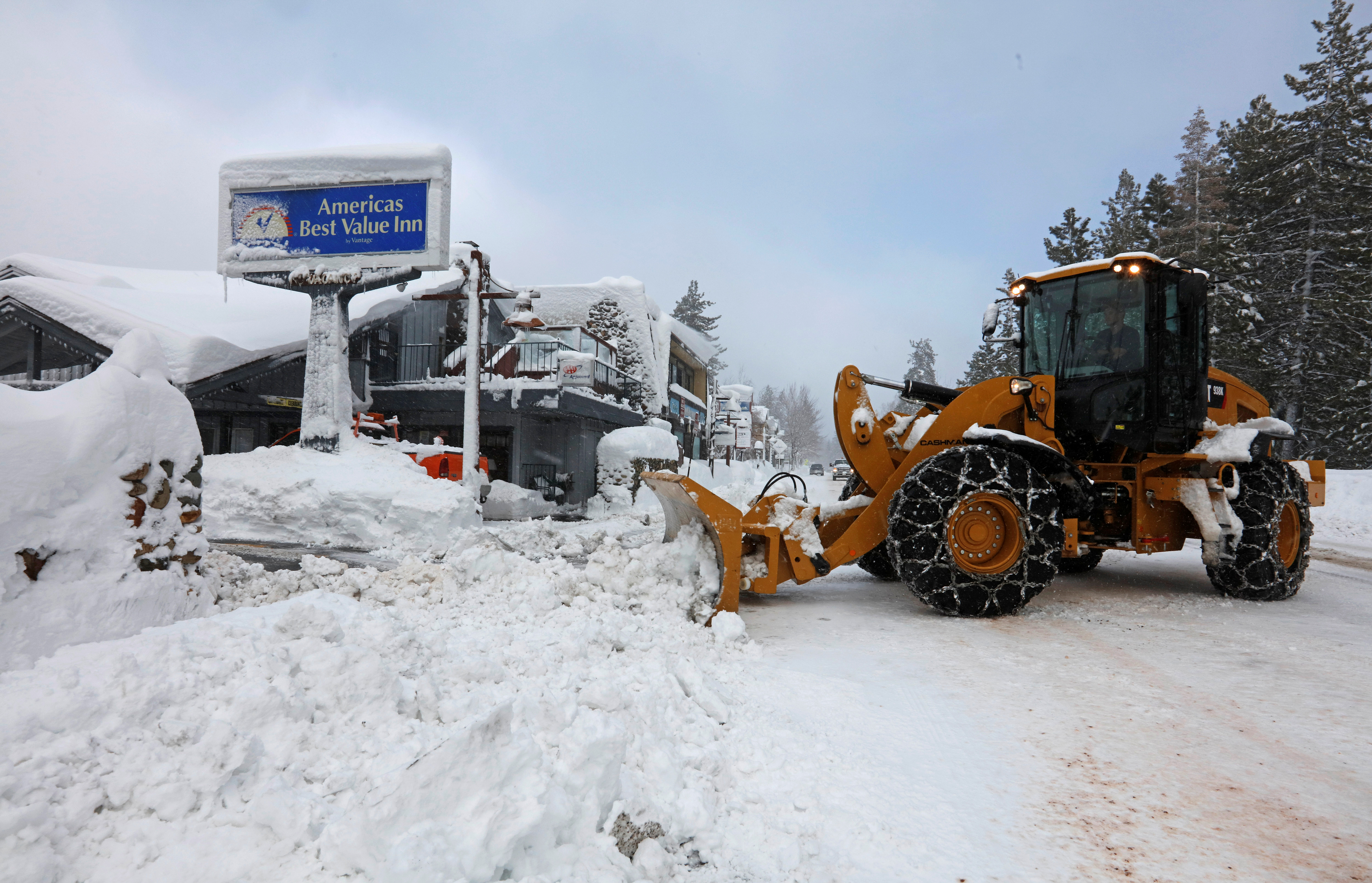 A plow clears snow after a heavy winter storm in Tahoe City, California.