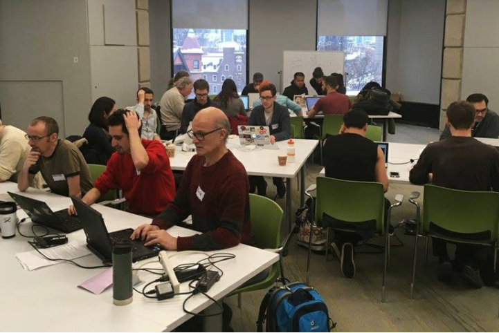 People work on identifying and archiving datasets with information about climate change at the Guerrilla Archiving Event in Toronto, Canada.