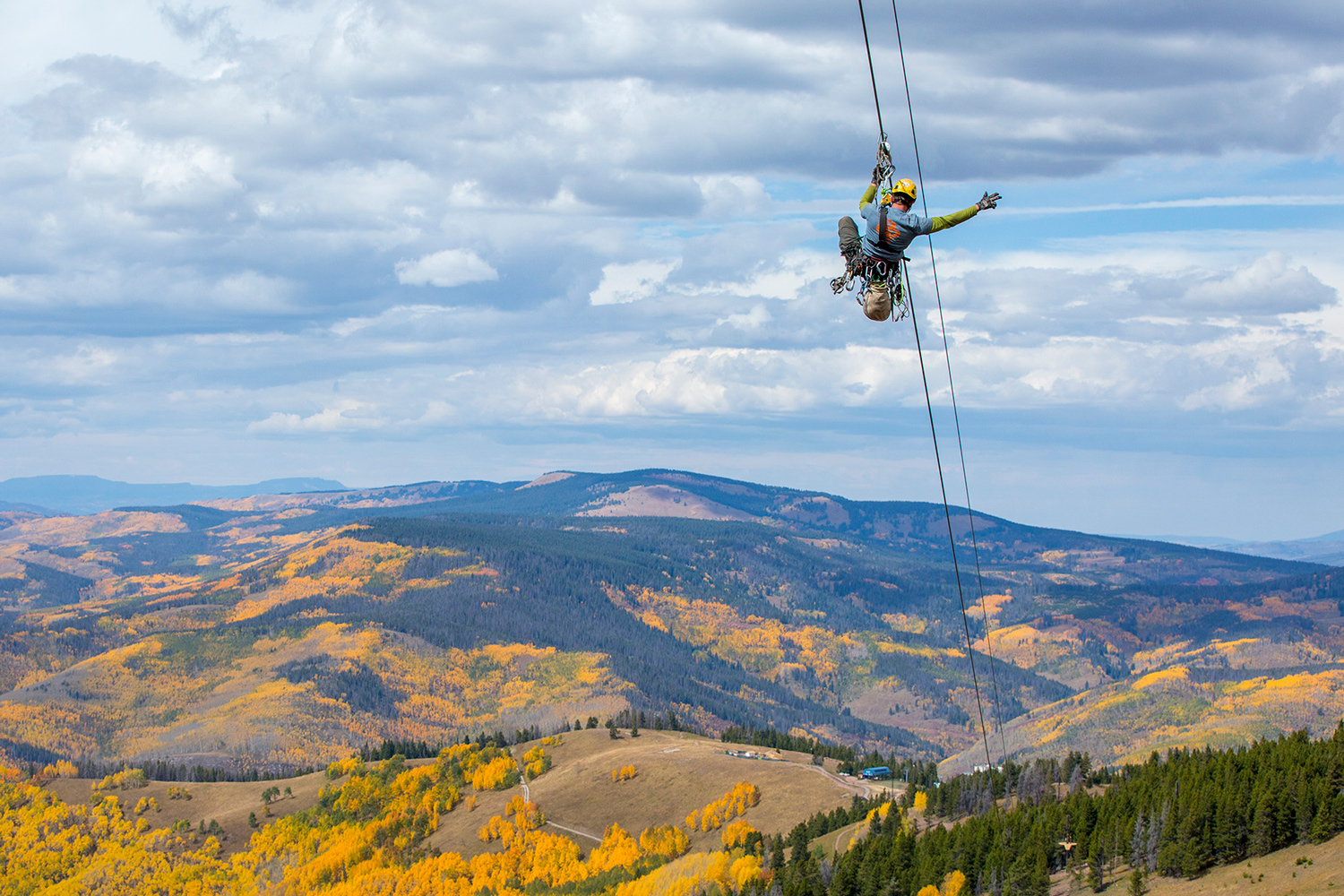 An employee tests the 1,200-foot-long zipline, which opened summer 2016 for Vail Resorts' summer activities.