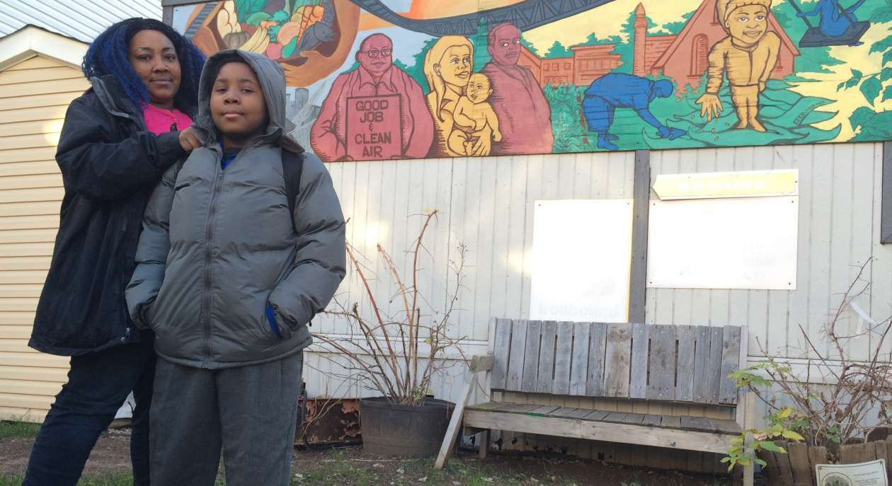 Tamika Bowers and her 10-year-old son, Tíyonn, outside an Ironbound Community Corp. building beside Tíyonn's school.