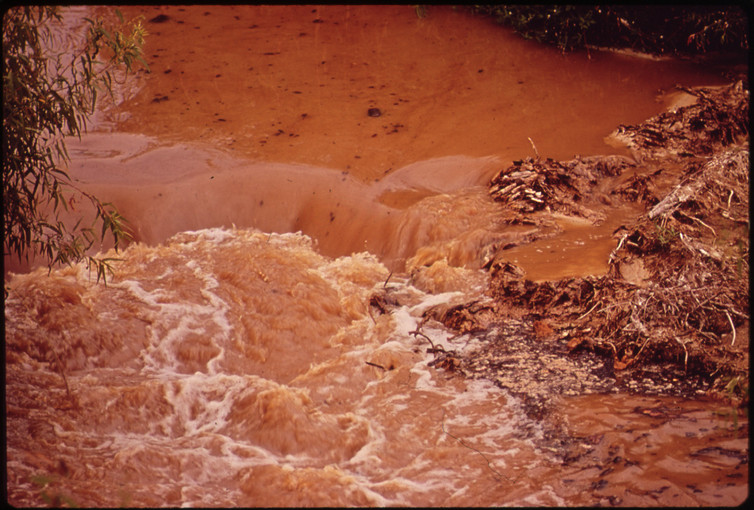 Wastewater from a paper mill in Louisiana pollutes water downstream in 1972.