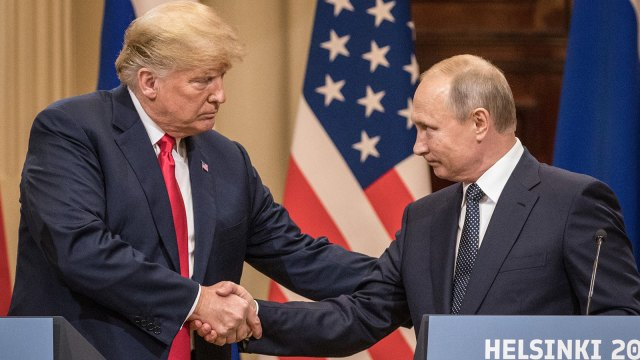 U.S. President Donald Trump (L) and Russian President Vladimir Putin shake hands during a joint press conference after their summit on July 16, 2018 in Helsinki, Finland.