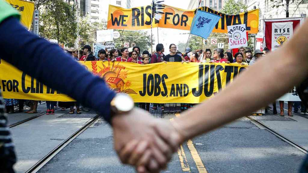 Crowds march up Market Street during the 'Rise For Climate' global action on September 8, 2018 in San Francisco, California.