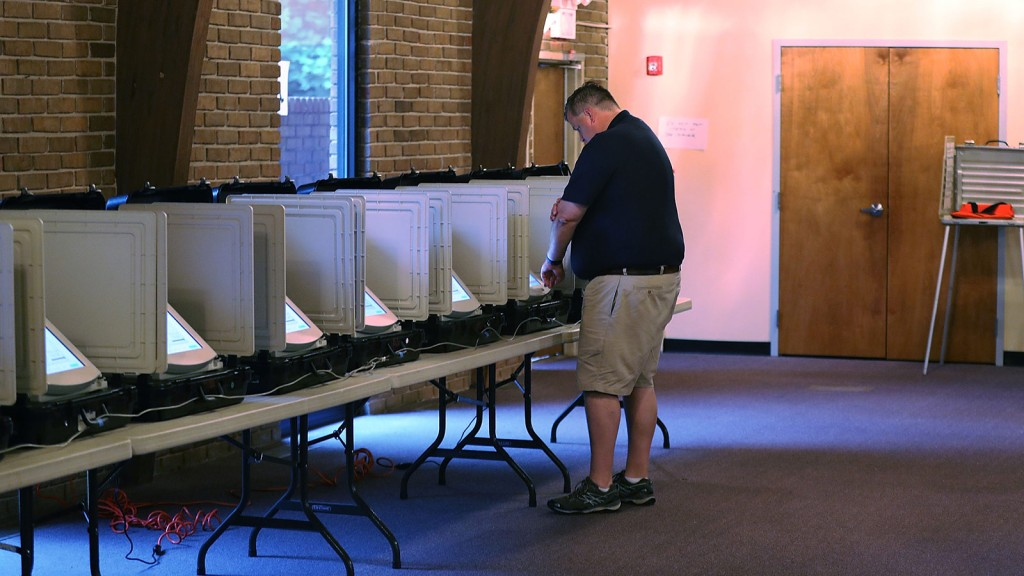 A voter casts his ballot during a special election in Georgia's 6th Congressional District special election at St. Bede's Episcopal Church on June 20, 2017 in Tucker, Georgia.