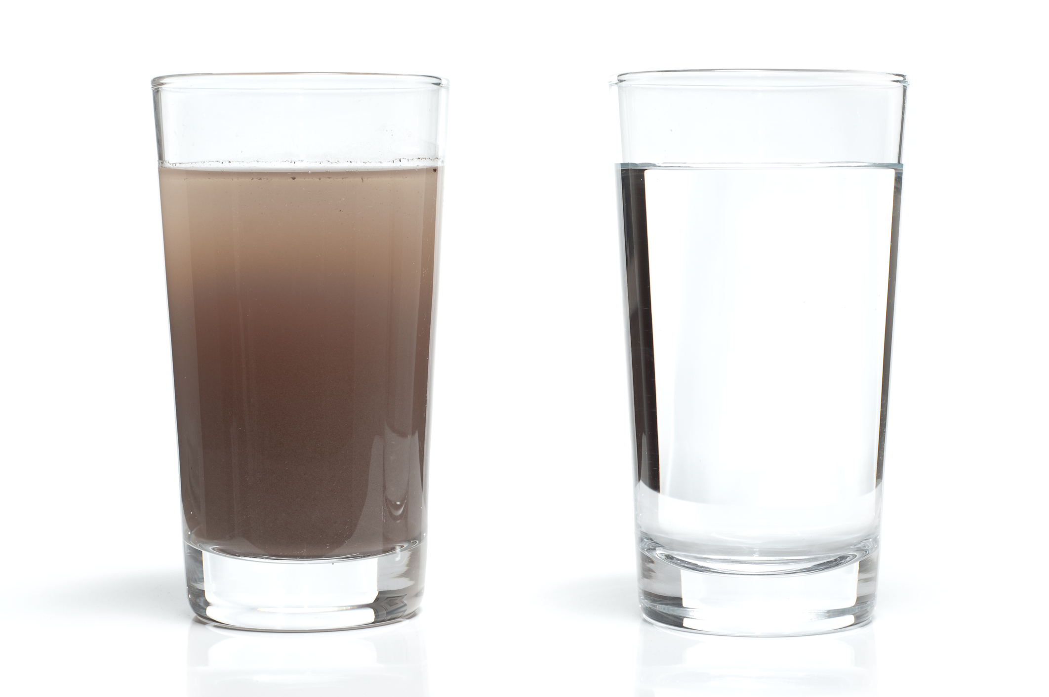 Two water glasses. One with dirty water and the other with fresh, clean water.