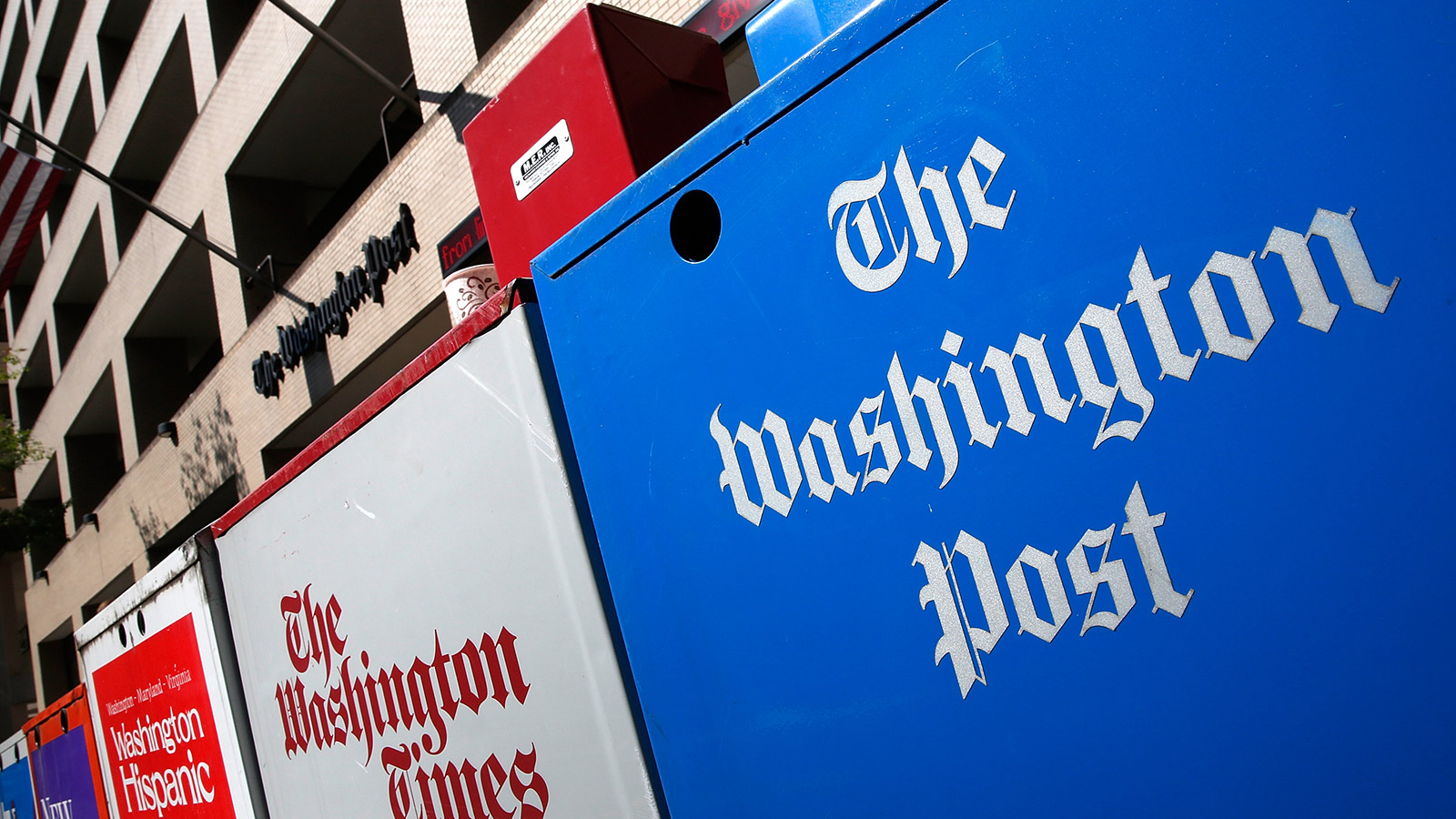 Newspaper boxes stand outside the Washington Post building