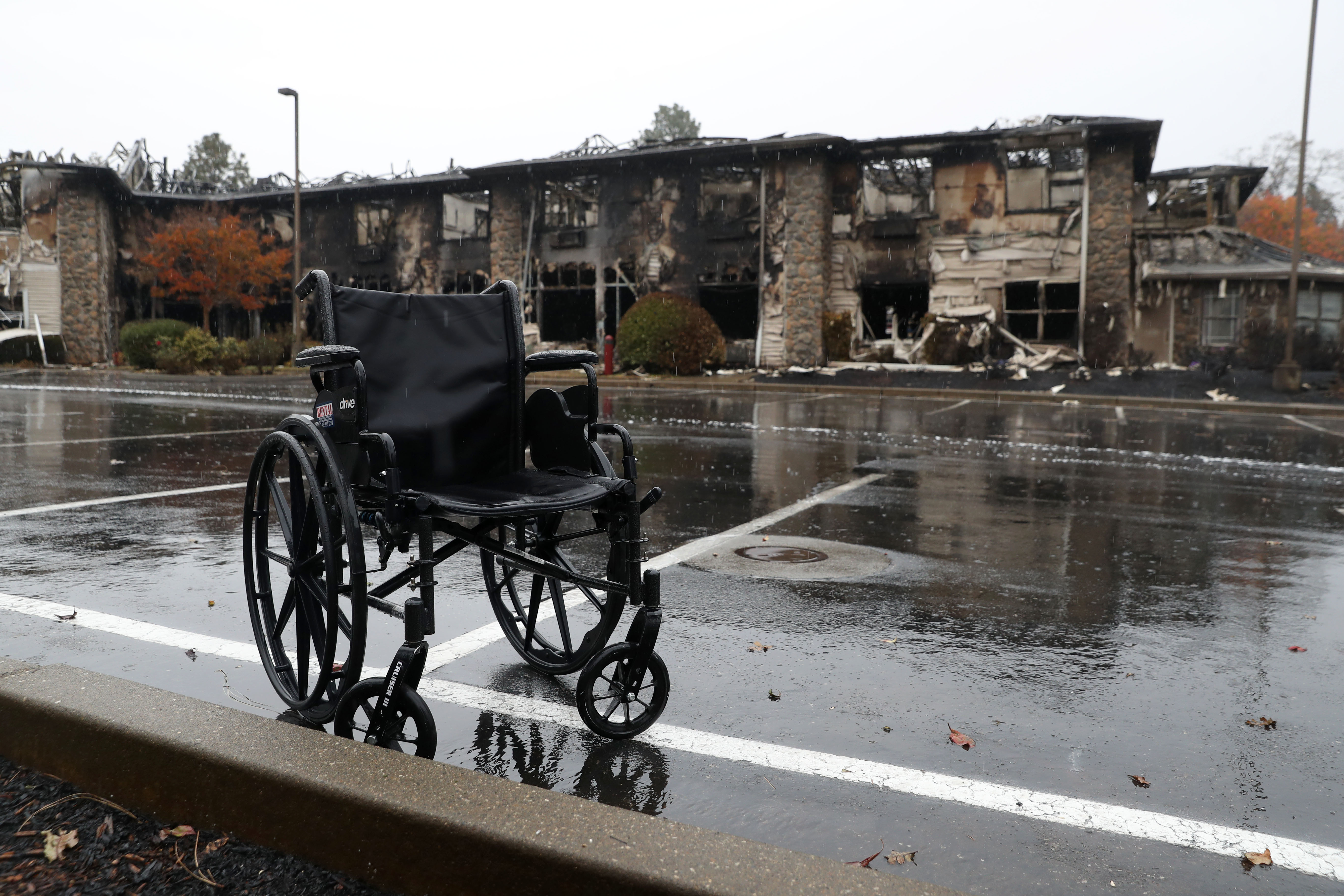 A wheelchair sits in front of a senior living facility that was destroyed by the Camp Fire in Paradise, California.