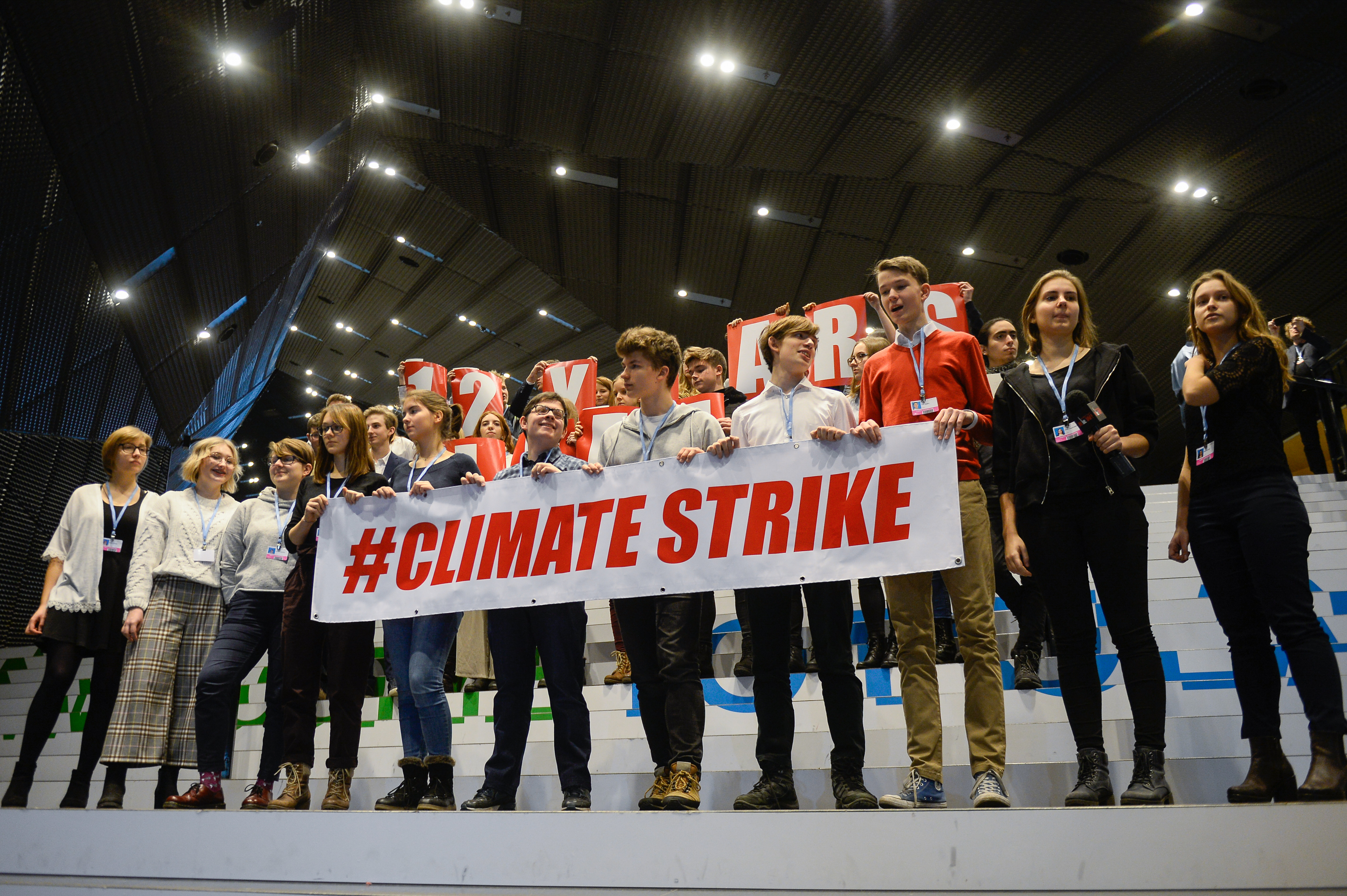 Polish students are seen holding a banner during a protest at the UN COP24 Climate Change conference, in solidarity with 15-year-old activist Greta Thunberg.