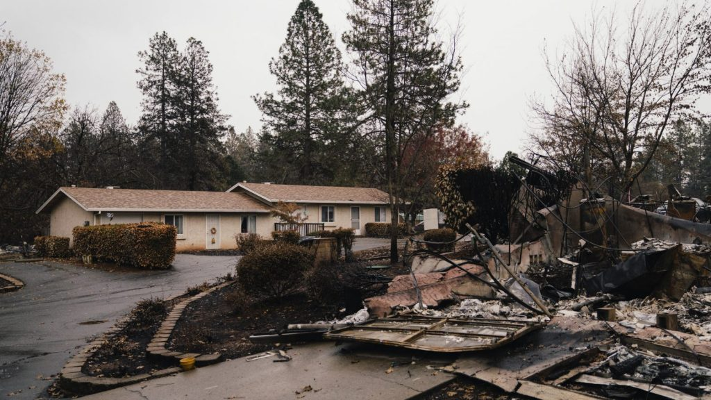 A residential apartment complex is seen standing among the debris of the Camp Fire in Paradise, California.