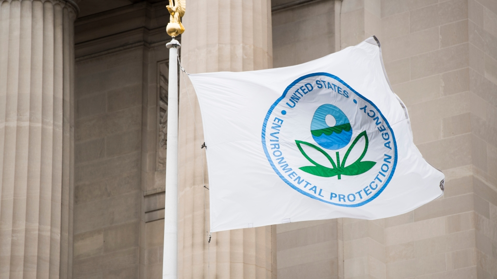 A flag with the EPA logo flies in front of the Environmental Protection Agency.