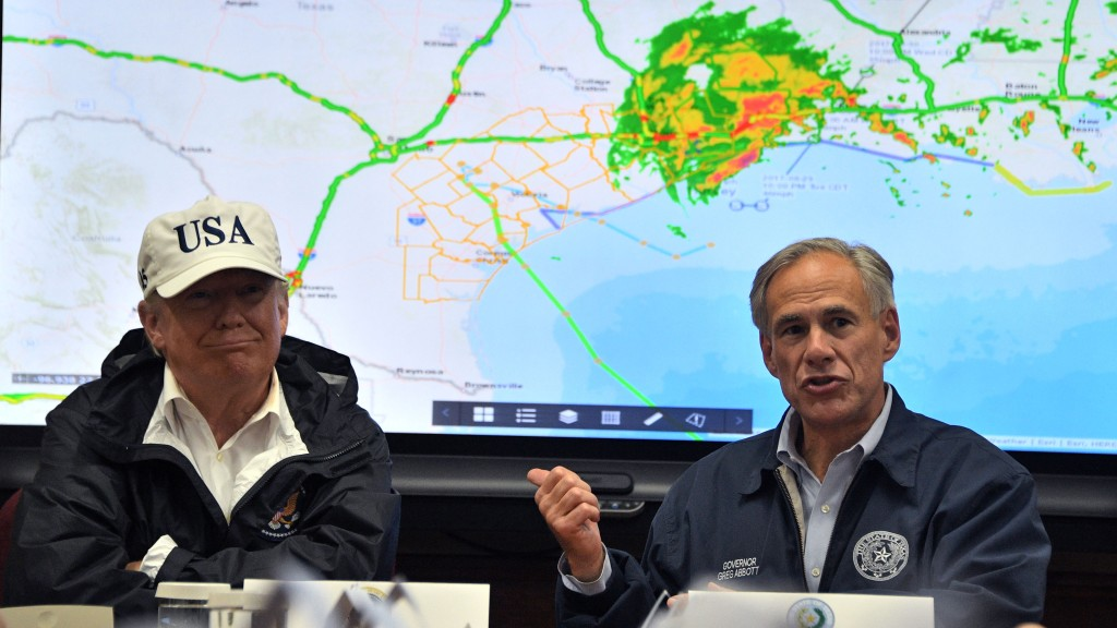 Texas Governor Greg Abbott speaks next to President Donald Trump in 2017, as rains from Hurricane Harvey continue to flood parts of Texas.
