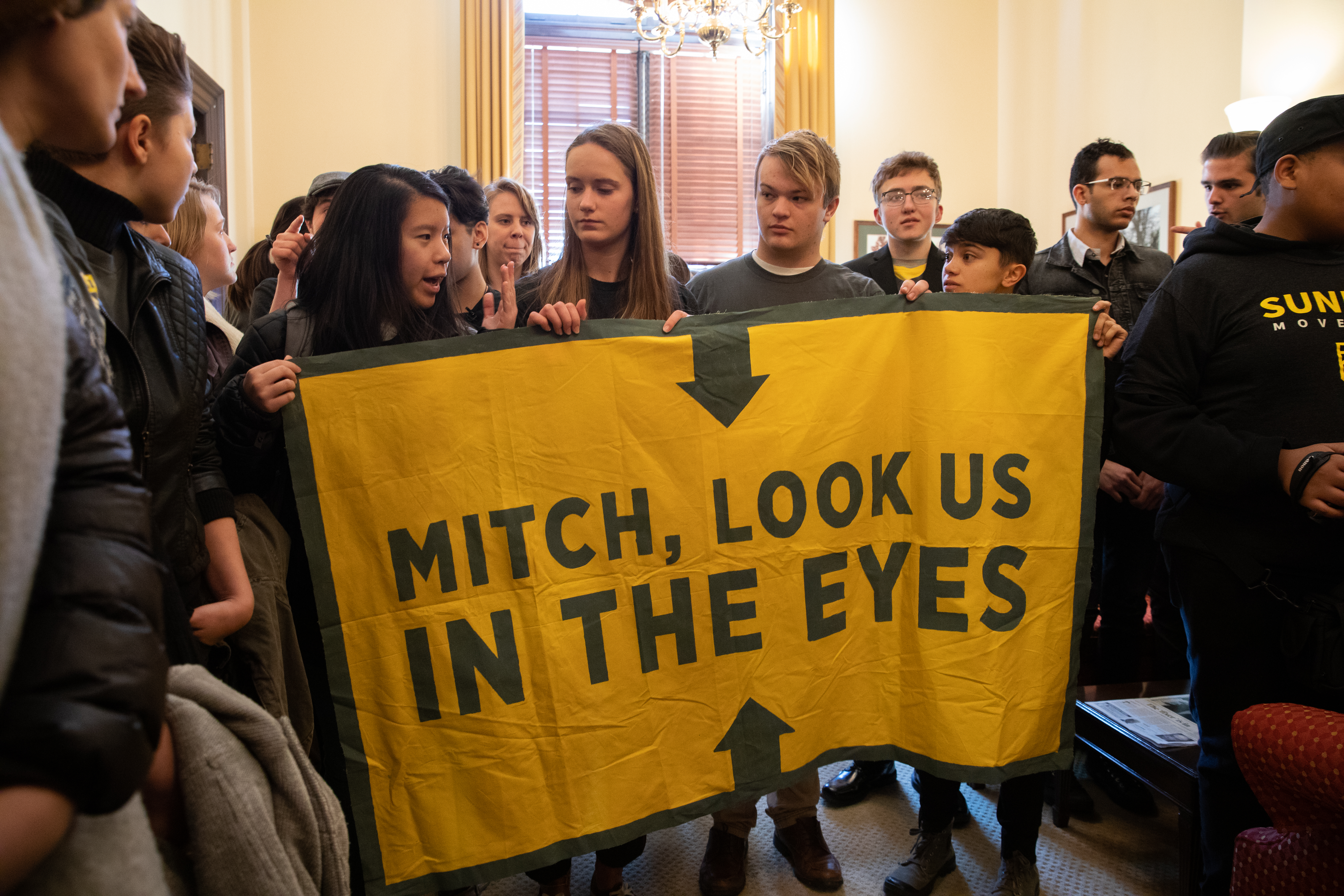 Young activists inside Senator Mitch McConnell's office.