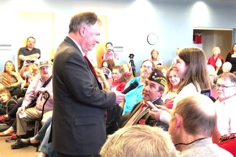 Coleman questions Republican State Representative Doug Lamborn in Colorado Springs last August.