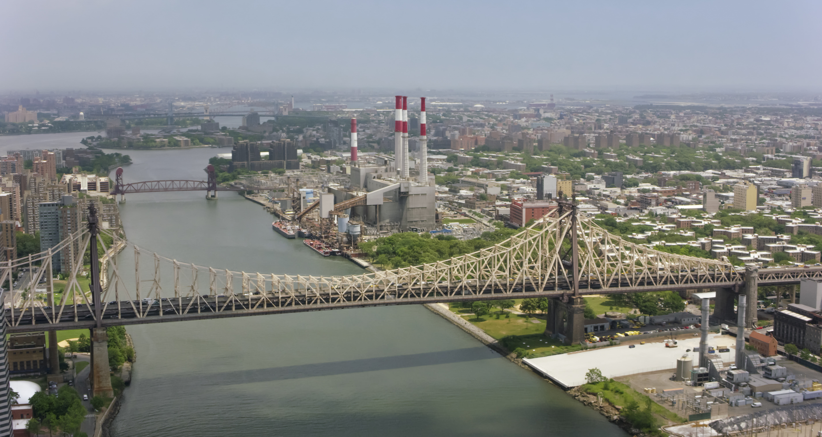 Aerial shot approaching the Ravenswood Generating Station in New York.
