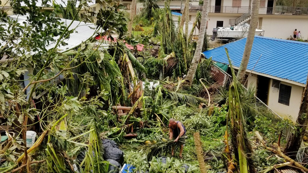 A resident clears up in Saipan after Super Typhoon Yutu caused widespread destruction across the islands of Saipan and Tinian