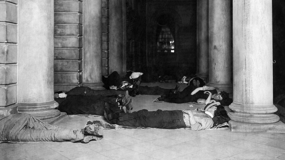 People sleep at the cool marble-floor of the City Hall during a heatwave.