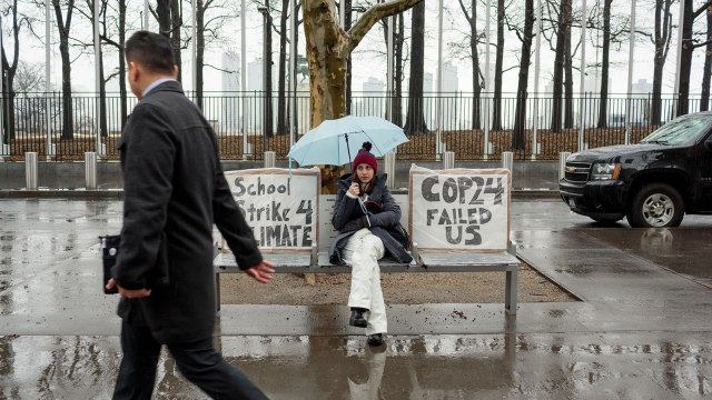 """Alexandria Villasenor skips school on Friday morning to strike in front of the UN, with signs reading: """"School Strike 4 Climate"""" and """"Cop24 Failed Us."""""""