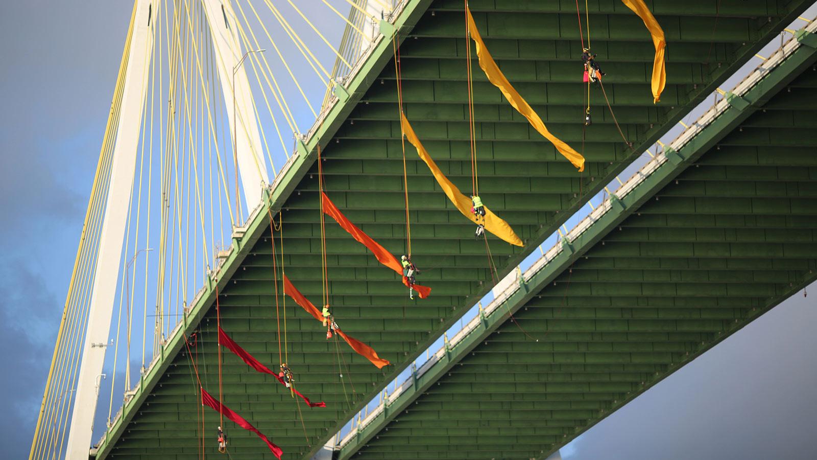 Greenpeace USA climbers form a blockade on the Fred Hartman Bridge in Baytown, Texas