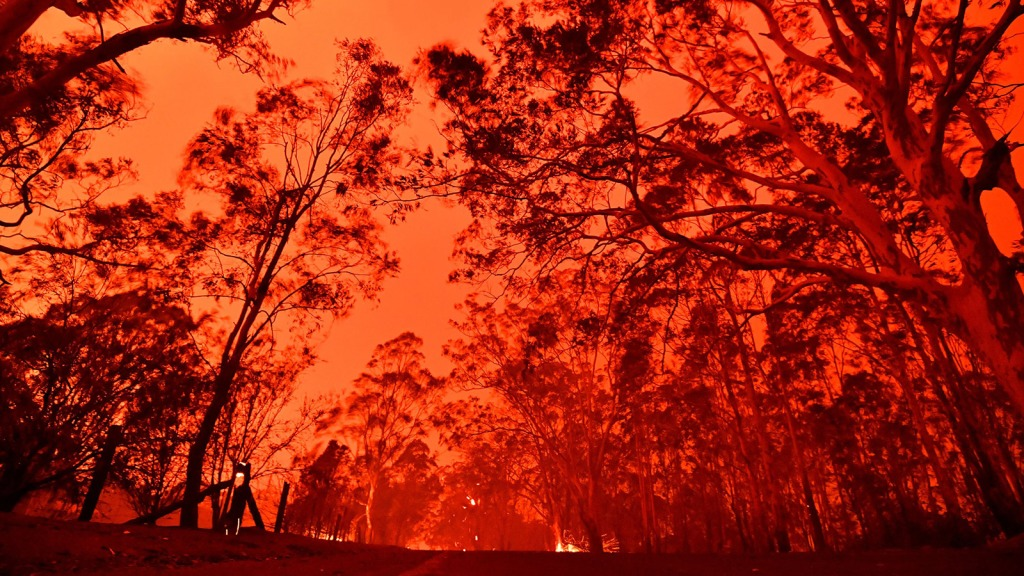 The afternoon sky glows red from bushfires in the area around the town of Nowra in the Australian state of New South Wales on December 31, 2019