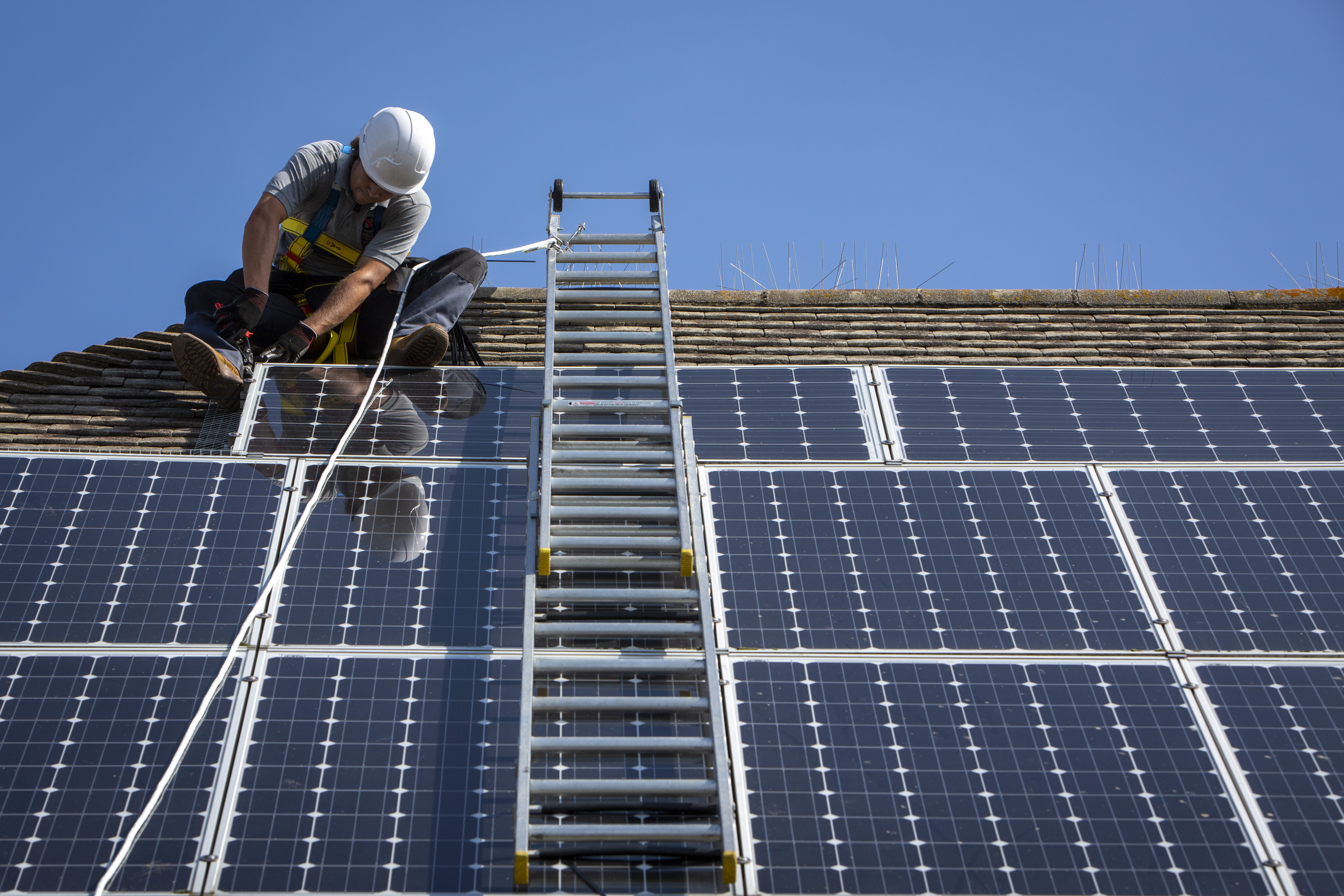 Rooftop solar worker
