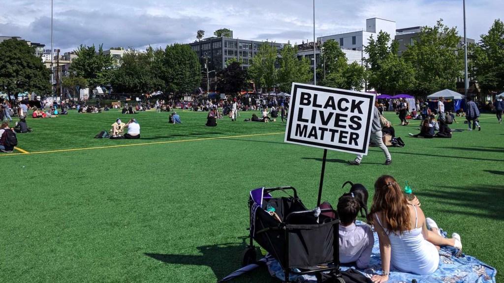 photo of Seattle autonomous CHOP zone picnic with black lives matter sign