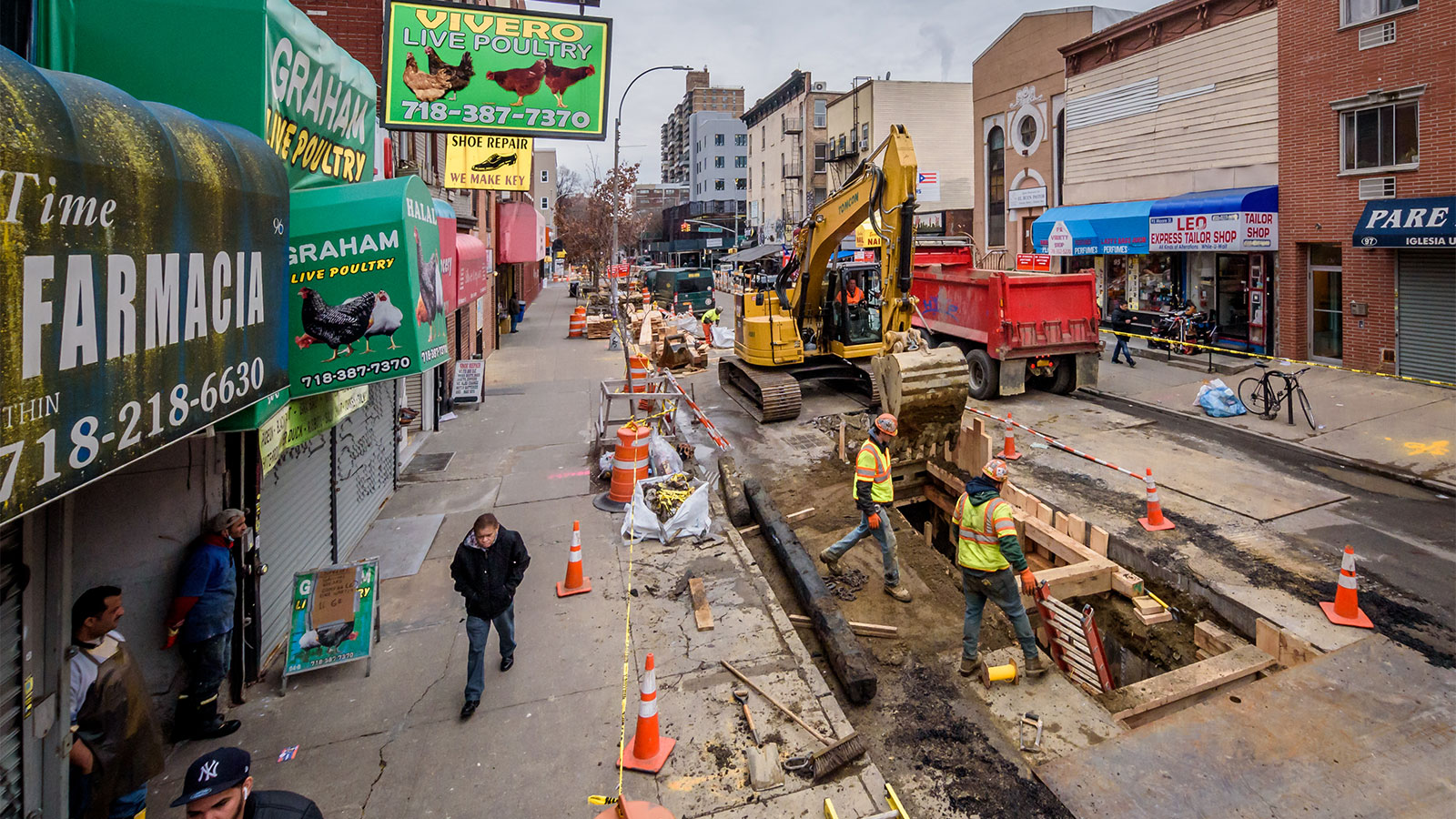 Heavy machinery and construction workers on Moore Street in Brooklyn