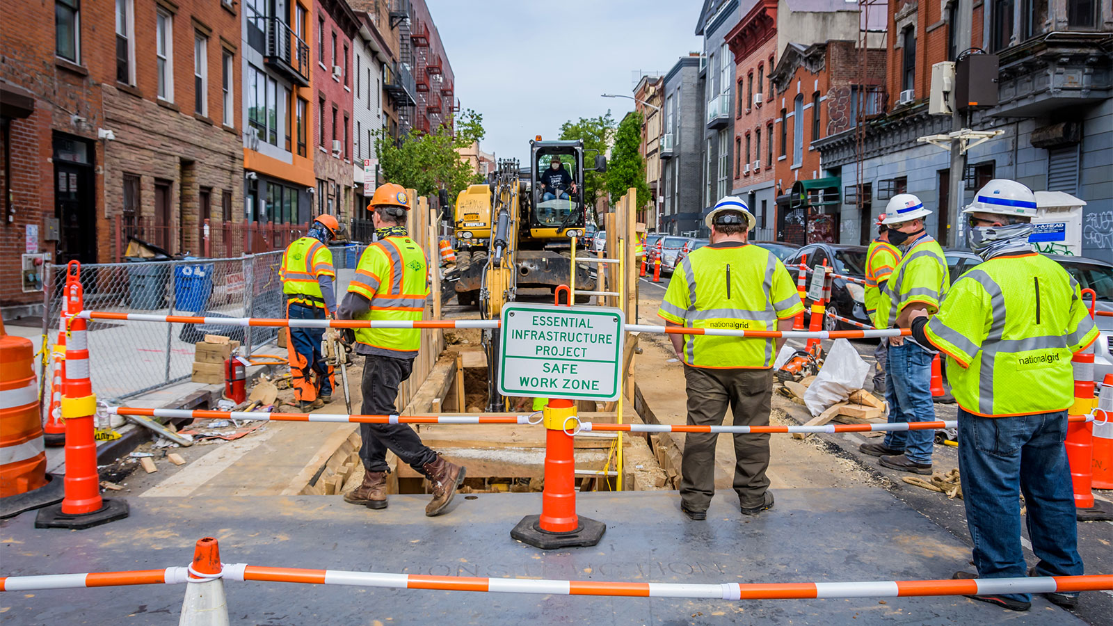 Heavy machinery and construction workers on Montrose Avenue in Brooklyn