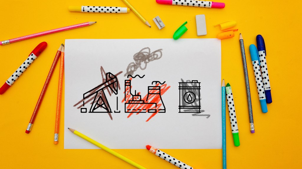 A piece of paper with an oil pump, a power plant, and cooling towers with markers and pencils surrounding the paper