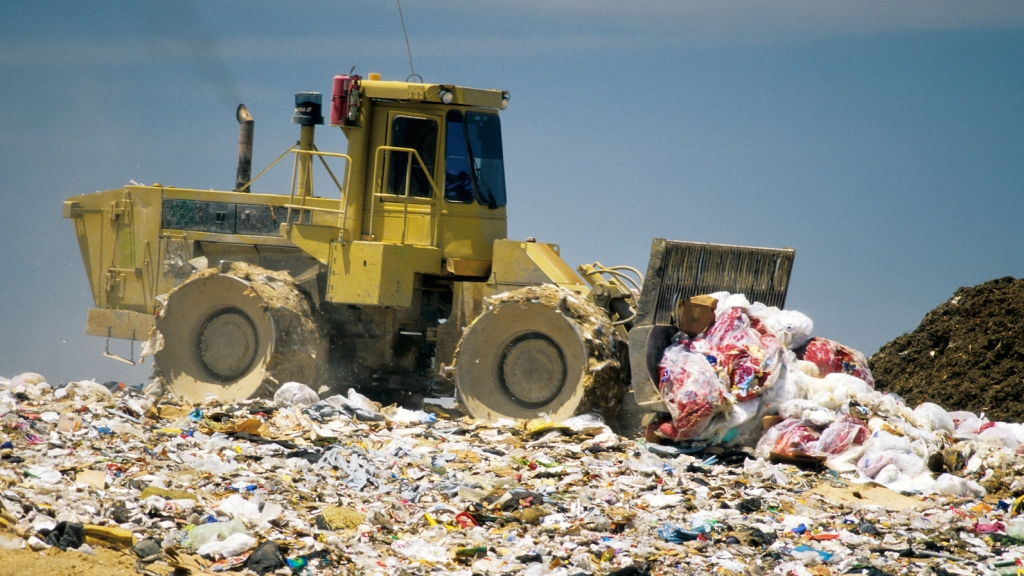 Compactor dumping trash in CA