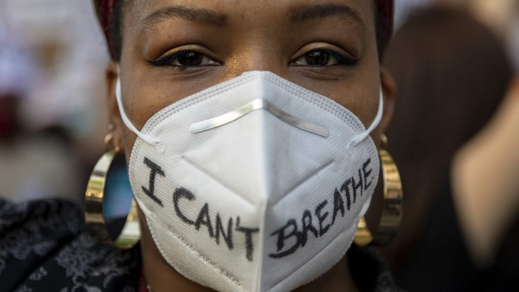 photo of protester in mask that reads I cant breathe
